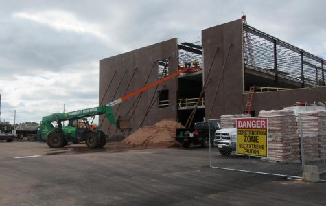 Workers using a lift rise to third floor at the build site of the future Superior High School on Wednesday.