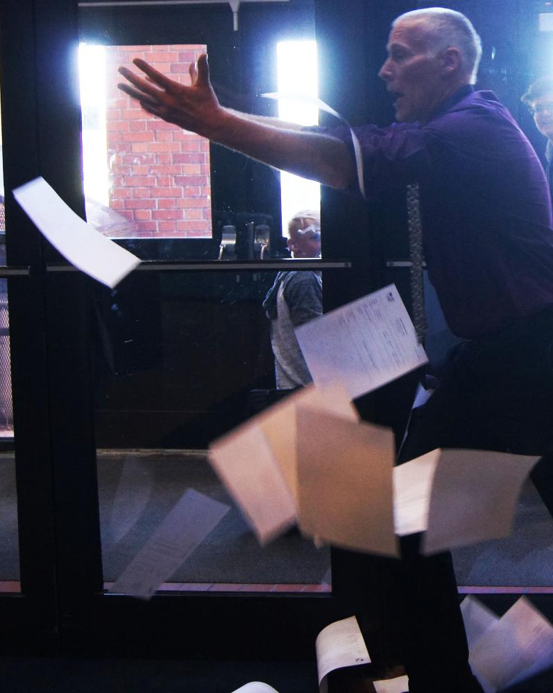 Bill Punyko throws stacks of referrals in the air on Thursday near the main office of SHS.