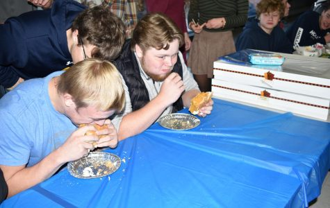 Seniors Michael Lajoie and Gunnar Gronski chow down on whole pumpkin pies during pie eating contest on Nov. 21st.