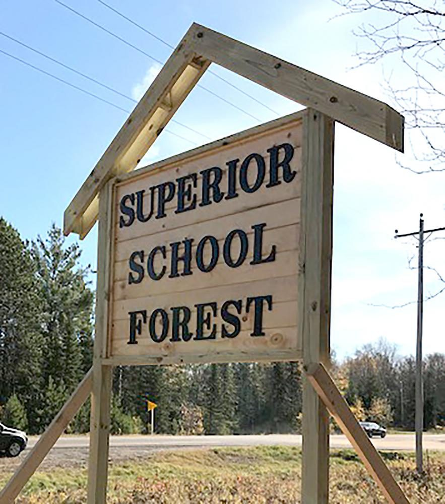The+School+Forest+sign%2C+made+by+Tyler+Karren%2C+stands+in+front+of+the+entrance+on+School+Forest+Road.