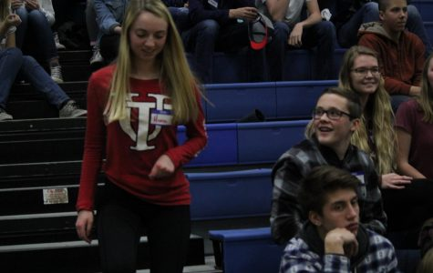 Sophomore Hanna Gothner gets called down for The Price is Right for a chance to win a portable charger at the Pledgemaker's Gameshow Extravaganza on Friday.