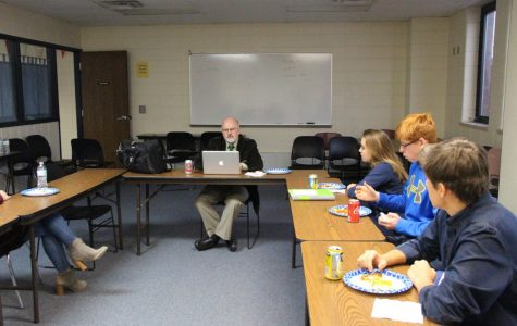 Students sit in the library conference room on Dec. 4 during A lunch to discuss a new superintendent.