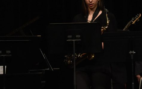 Junior Rae Dunbar prepares to play her saxophone in the jazz concert on Tuesday.