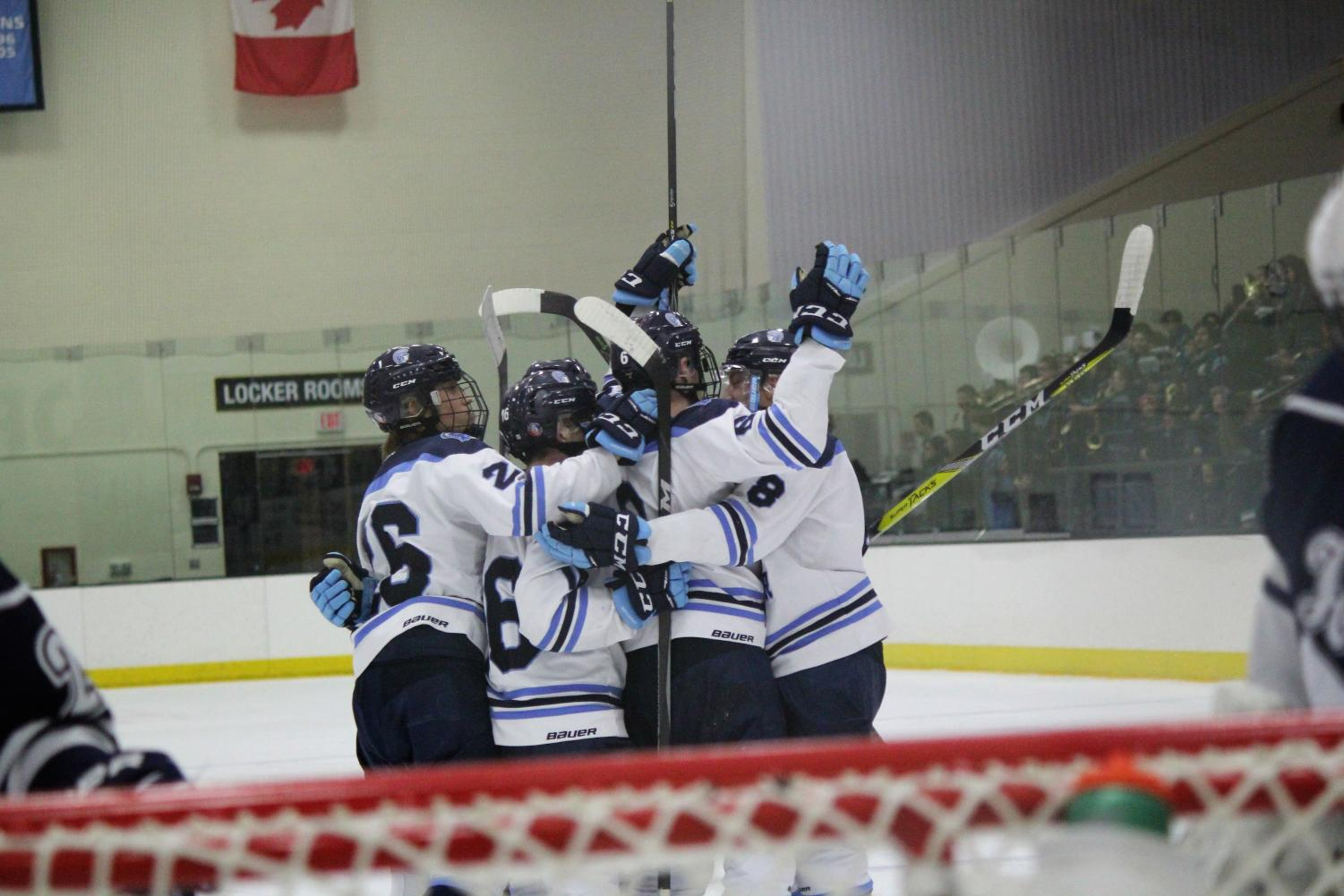The Spartans celebrating their first goal scored by junior Trevor Dalbec (21)