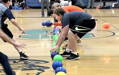 Teams 9-2 and 9-3 face off for the first game of Toys for Tots dodgeball game on Tuesday.