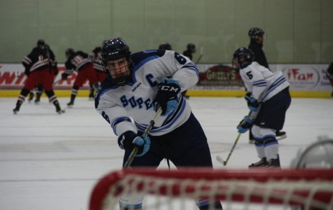 Senior Max Plunkett goes for a shot during warm-ups on Feb. 1 at Wessman Area against the Duluth East Greyhounds.