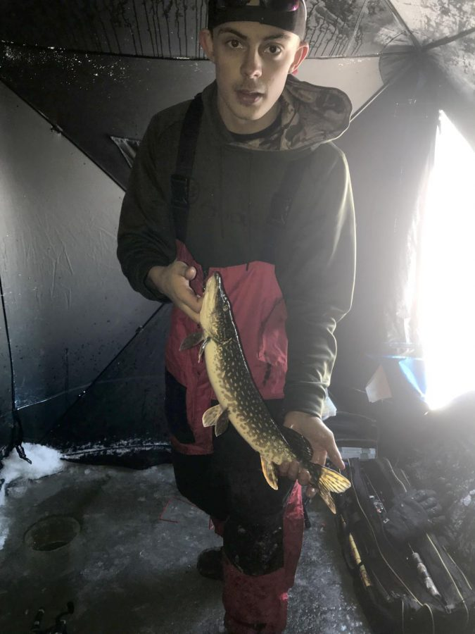 Senior+Michael+Strong+holds+a+Northern+he+caught+on+Jan+1+on+Spooner+Lake.+