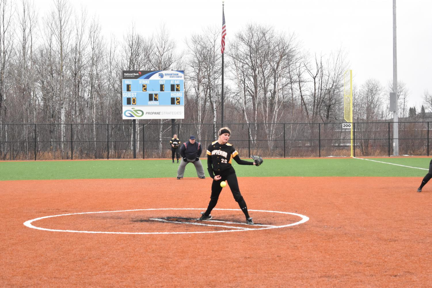 The UWS womens' softball team pitching during a game on the Spartan softball fields.