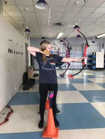 Senior Tailyn Bennett practices for nationals on Thursday, April 12 in the cafeteria.