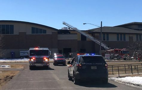 A Superior Police Department car and a Superior Fire Department truck block the street as firefighters put out fire on April 9 at the new Cooper Elementary building on 1642 Pennsylvania Ave.