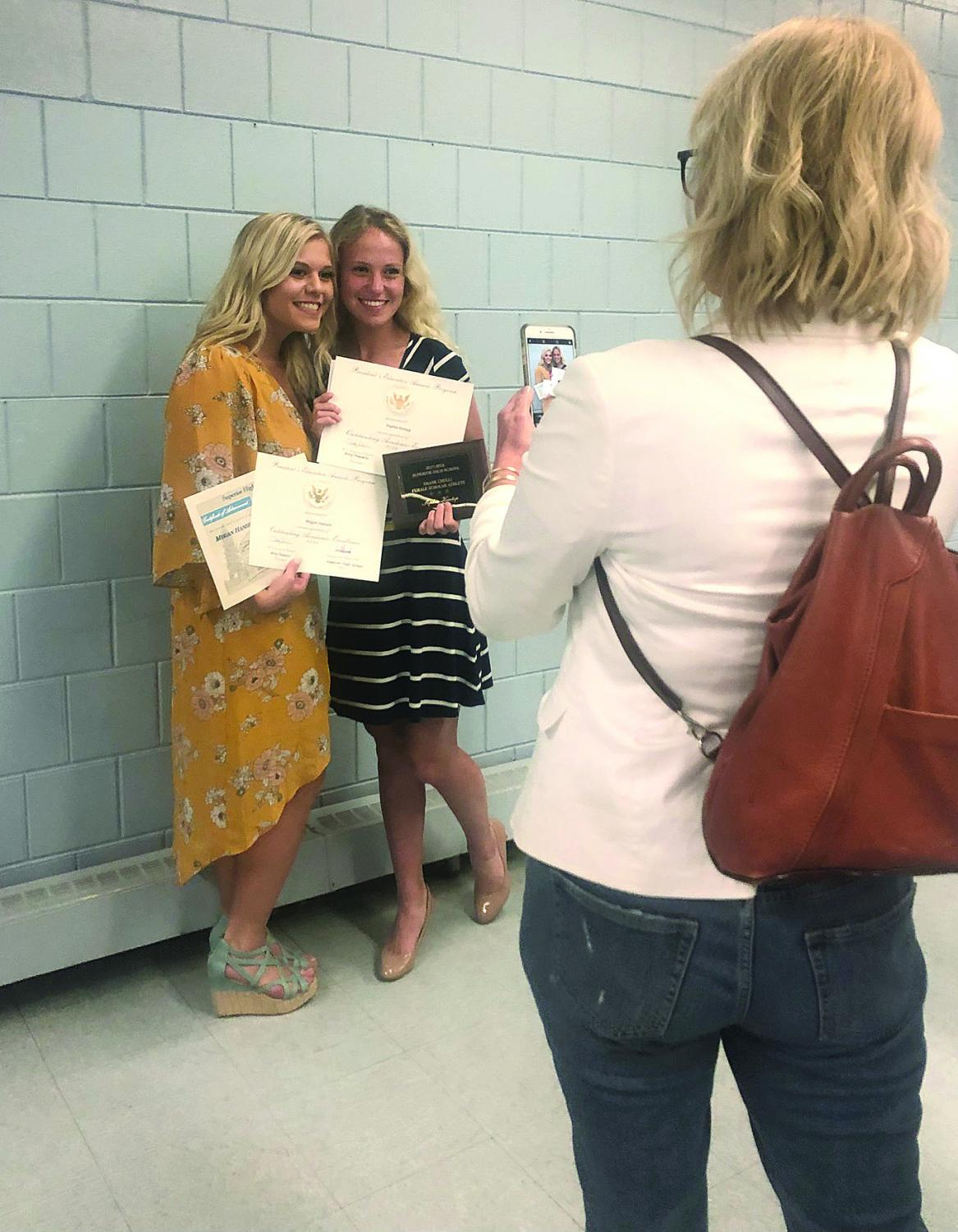 Seniors Sophie Kintop and Megan Hanson pose for a photo after Honors Night on Wednesday, May 30.