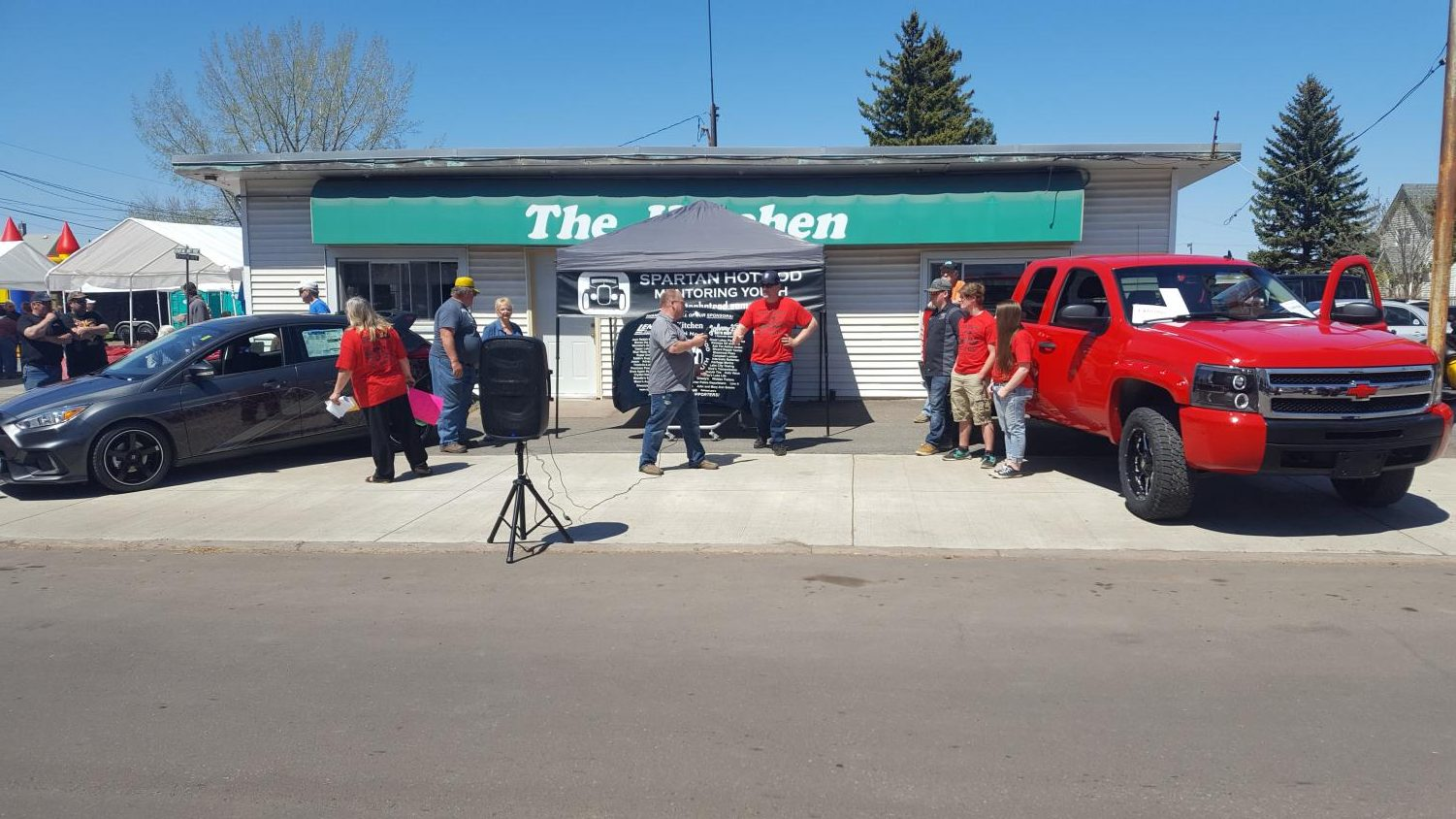 Mentor Brad Engstrom talks before the auction of the truck on May 20. The truck was worked on by seniors for their senior project then sold at the car show at auction.