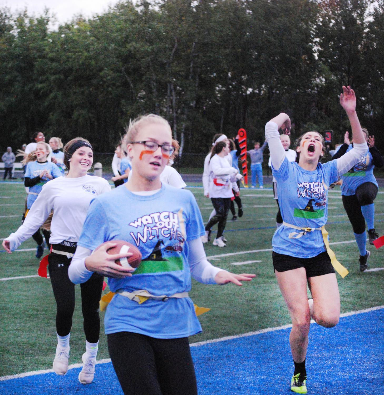Senior Erin Walpole scores touchdown against Sophomore team in Powderpuff game on Wednesday, Oct. 3.