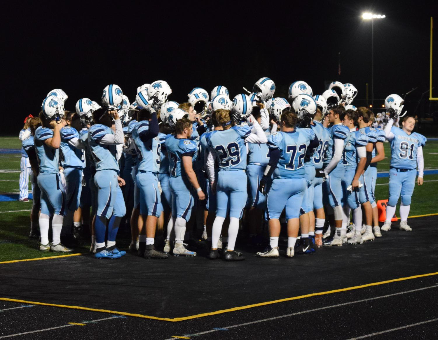 Cutline: Spartan football team huddles together as a team On Friday October 5th at Superior High sports complex