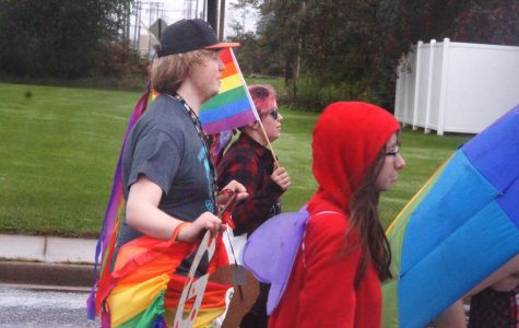 Senior student,Tristin Longstreet, marching alongside his friends and GSA members on Oct. 6, prior to the homecoming football kick off.