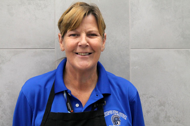 Lunchroom staff member, Kym Nepper, poses inside SHS cafeteria  on Oct.22.
