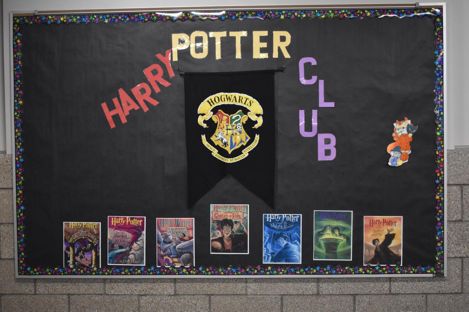 The Harry Potter billboard advertising the club outside the club room 2137