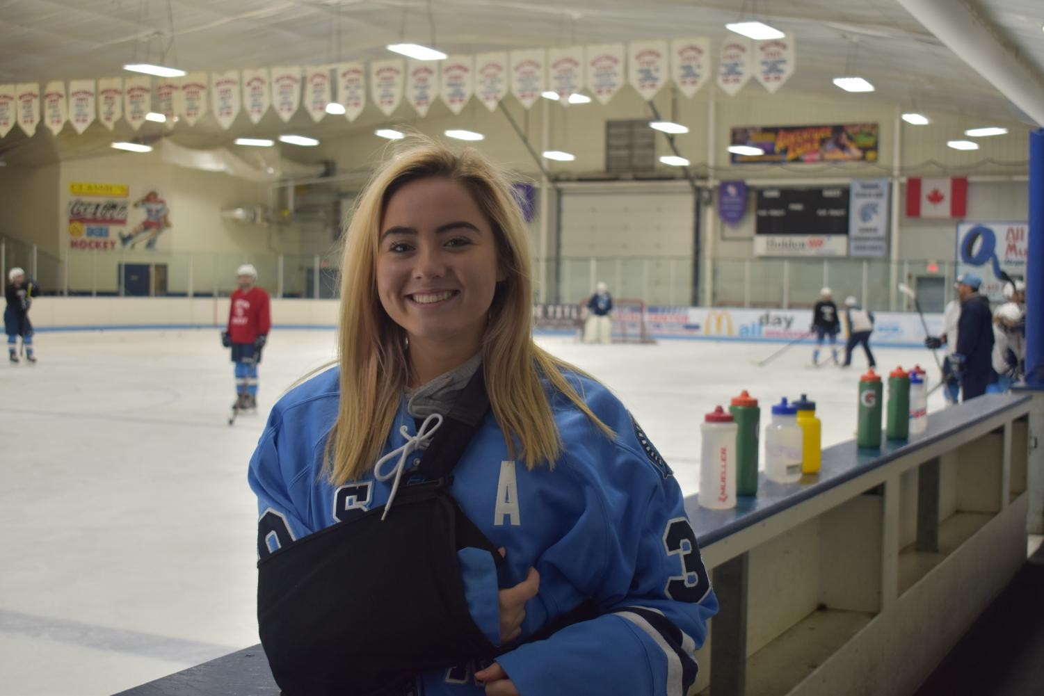 Senior captain goalie Autumn Siers stands in front her teammates during a practice, displaying her torn rotator cuff.  Siers is currently being replaced by Sophomore Katrina Casper.