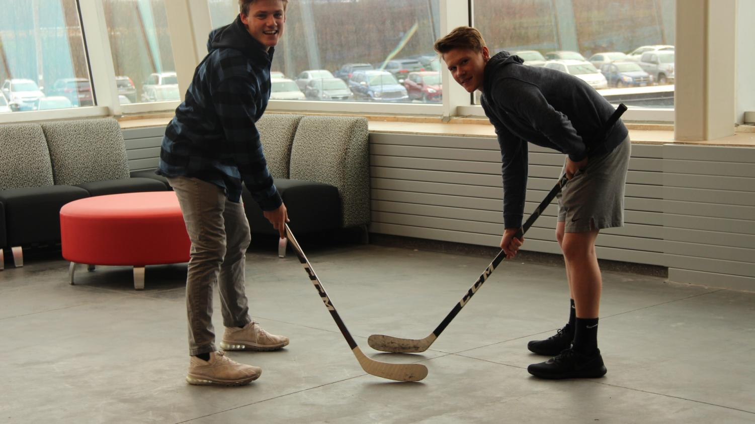 Juniors Spencer Gudowski and Gunnar Hansen face off in the 2nd floor balcony on November 6. The two hockey players are both participants in the Fellowship of Christian Athletes club.