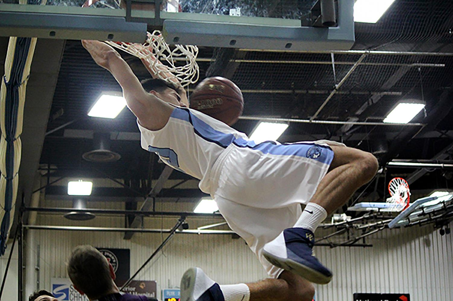 Senior Mason Ackley dunks on Eau Claire Memorial in the Superior High School gym on Tuesday Nov 27.