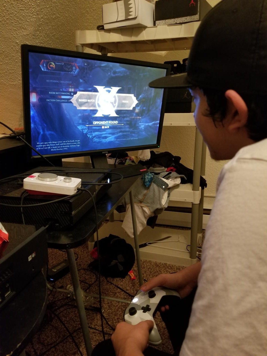 Daniel Villalobos plays Mortal Kombat X at his home on Dec. 8th.