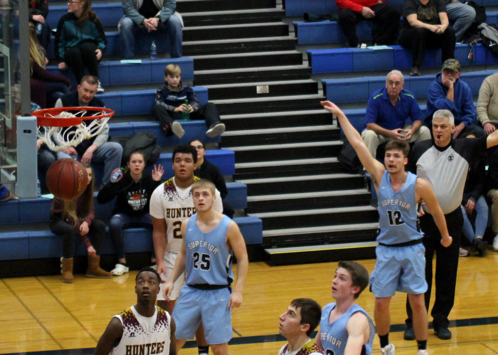 Senior Beau Severson (12) sinks a 3-pointer against Duluth Denfeld in the SHS gym on Dec. 6.