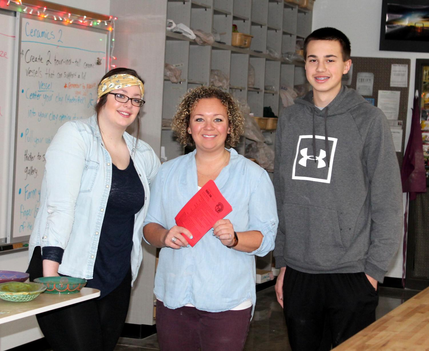 Sophomore Student Council representative Mara McGillis, stands with Student Council advisor, Nikkee Francisco and sophomore Isaac Domitrovich in the Ceramics room on Dec 12. McGillis and Domitrovich along with Francisco are working on putting on Bring on the Break which will be held the week of Dec 21.