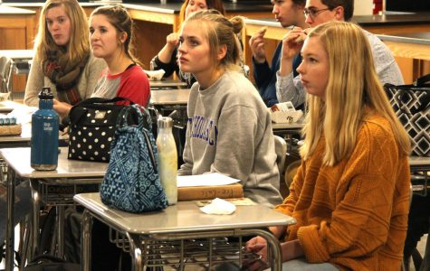 Seniors right to left)  Bridget Beyer and Lauren Raboin in an Interact meeting in room 1154 on Nov. 27.