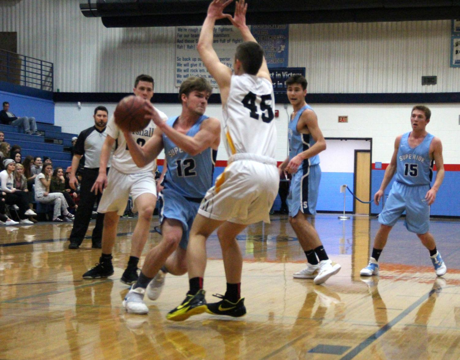 Beau Severson (12) drives to the hoop during the first half of the Spartans game with Duluth Marshall in Superior on Jan. 7. Severson paced the team in scoring with 20 points.