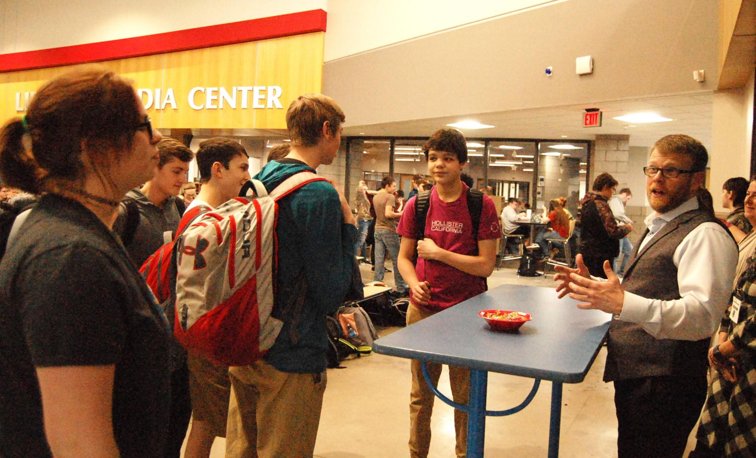 Junior Kaitlynn Andrs (left) talking to Mayor Jim Paine (right) in the Spartan Commons Wednesday, Jan. 16.