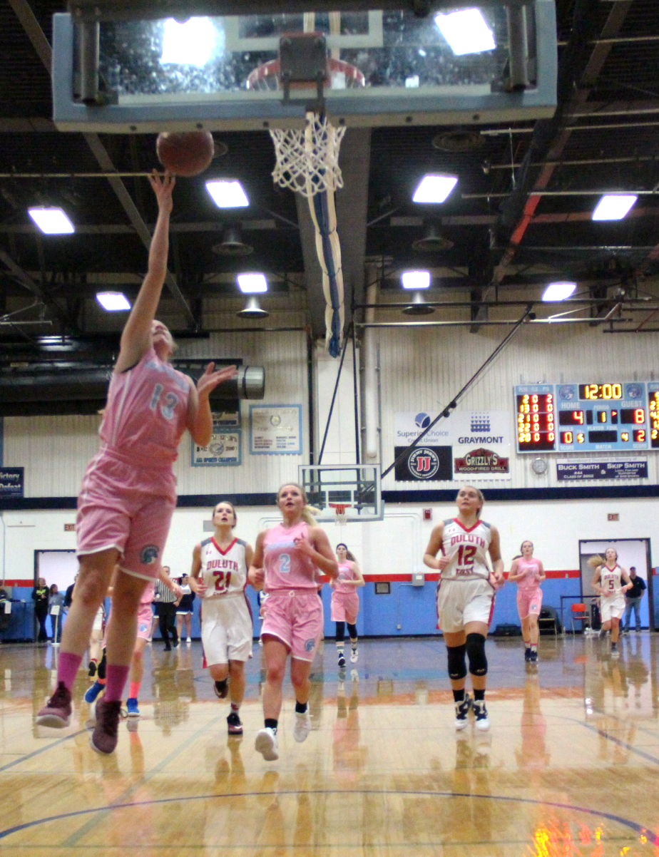 Junior Niya Wilson (13) soars in for a fastbreak layup with senior Chloe Kintop (2) trailing for a rebound. The Spartan girls won 53-44 on the third annual Coaches vs. Cancer event night.