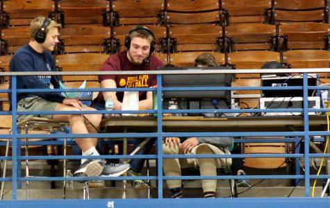 Junior Brennan Morrissey (left) and senior Gabe Sexton report on the girl's basketball game Dec. 4.