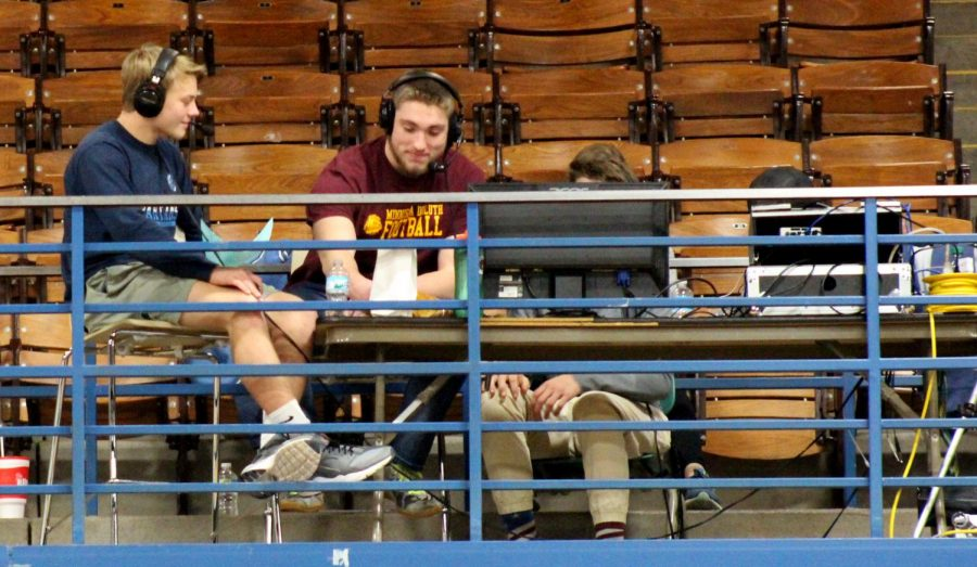 Junior+Brennan+Morrissey+%28left%29+and+senior+Gabe+Sexton+report+on+the+girl%E2%80%99s+basketball+game+Dec.+4.%0A