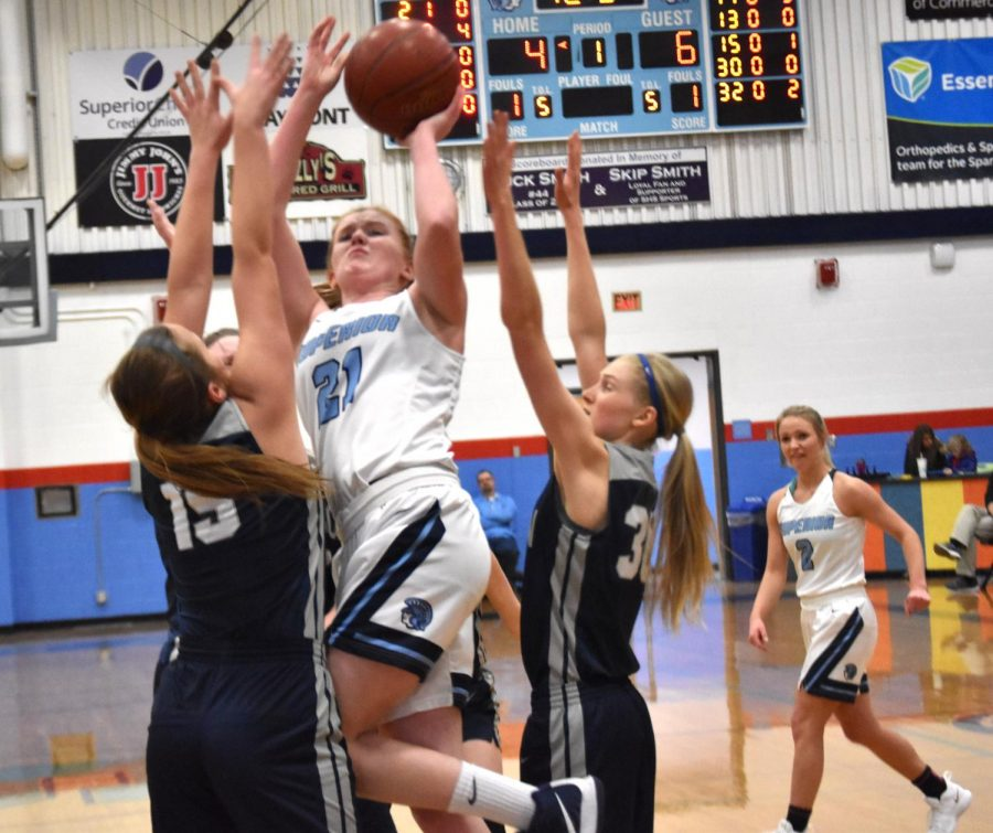Junior+Kaileigh+Miller+goes+up+for+a+layup+early+in+the+first+half+of+yesterday%E2%80%99s+game+against+Hudson+in+the+SHS+gym.+The+final+score+was+53-42+in+favor+of+Hudson.