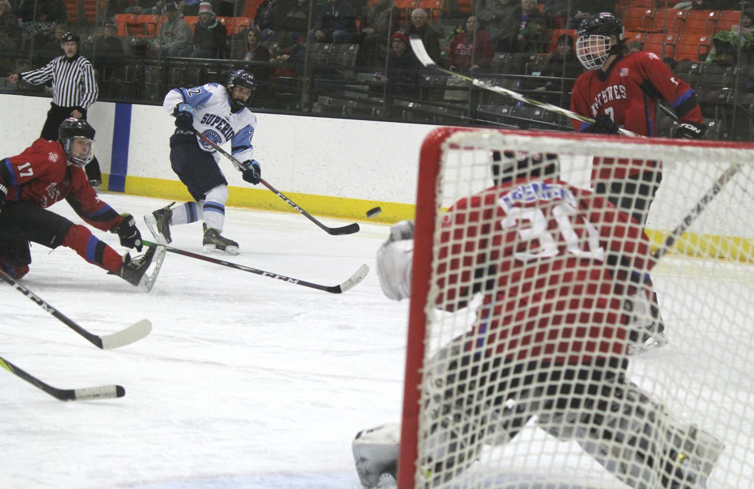 Senior Derrick Mattson (22) makes a shot on goal saved by Northwest goalie Jonah Becker at Wessman Arena last during the boys hockey game. Superior won 7-0 and advances to the Section 1 semi final on Tuesday against New Richmond.
