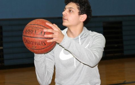 Sophomore Malachi Simiyu practices shooting in SHS gym on Feb. 15. He measures his improvements made from the Fitnessgram testing in his gym class.