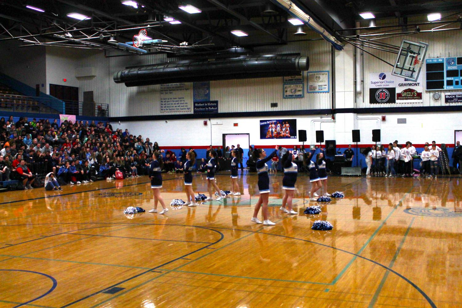 "The Cheer Team performs ""We Are The Spartans"" in the gym during the Snow Week assembly on Feb. 1."