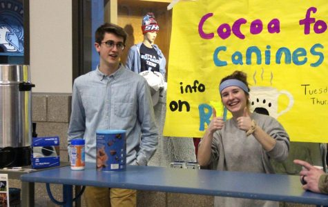 Senior Willem McClellan and junior Claudia Androsky speaking to a potential customer in the Spartan Commons directly outside of the Spartan Shack on Feb. 15. These two Interact students were selling cocoa for funds to be donated to the Douglas County Humane Society.