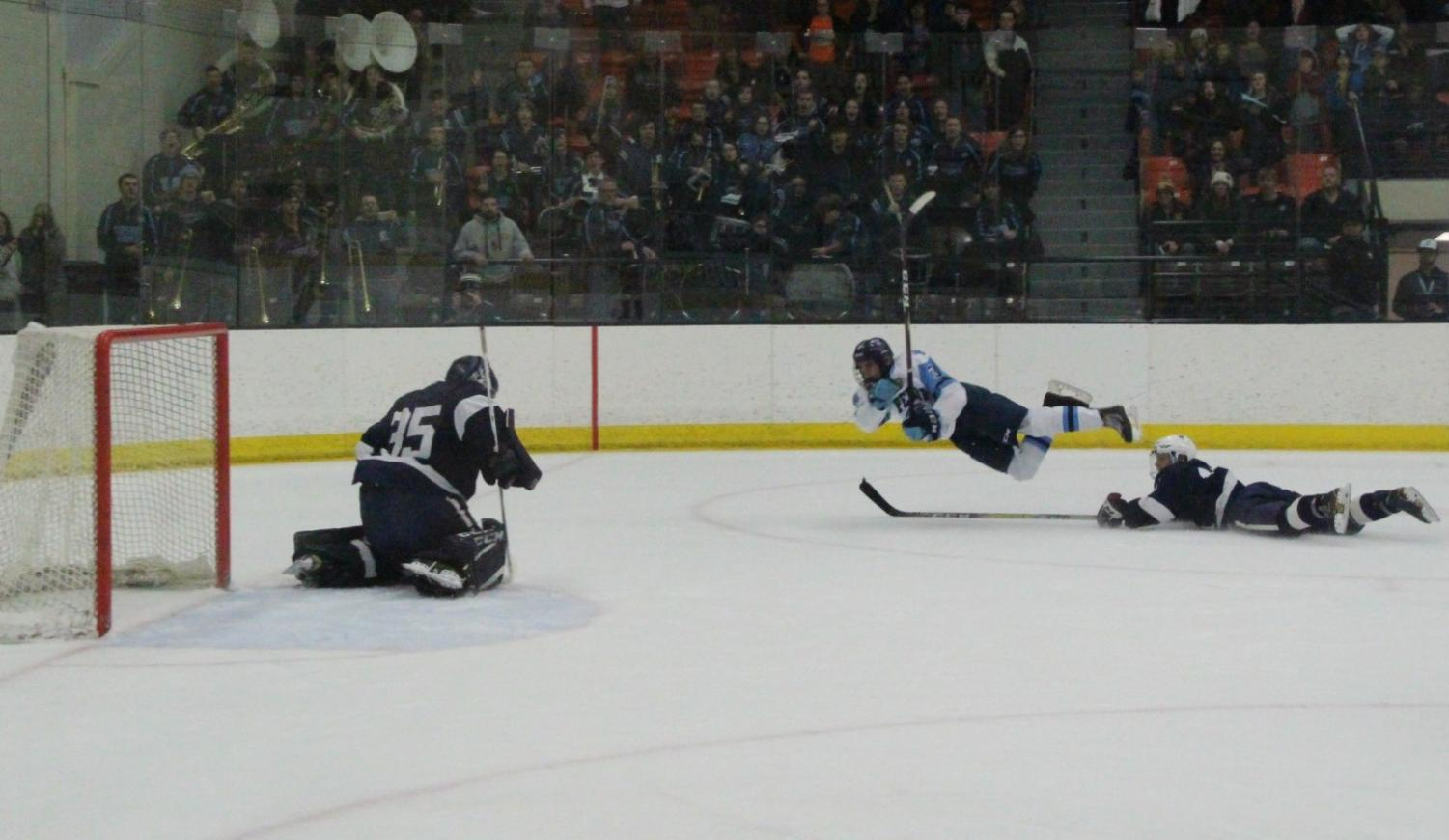 Junior Kobe Hansen attempts a shot on goal late in the first OT period against Hudson in the WIAA Section 1 final at Wessman Arena tonight. Hudson defeated Superior 2-1 in double OT, advancing to the State Tournament and ending the season for Superior.