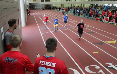 Junior Jarret Gronski and senior Steven Pearson time an event at the 5th grade Track-O-Rama on Mar. 7.  The high schools next meet is on Friday, Mar. 29.