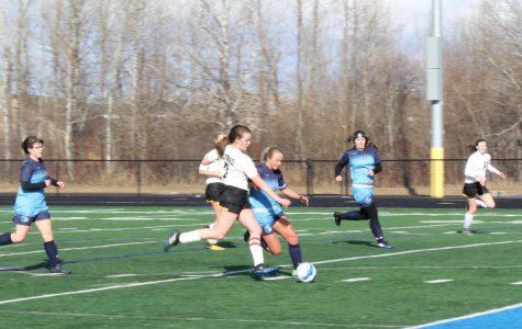 Spartan girls fight to tie in season opener