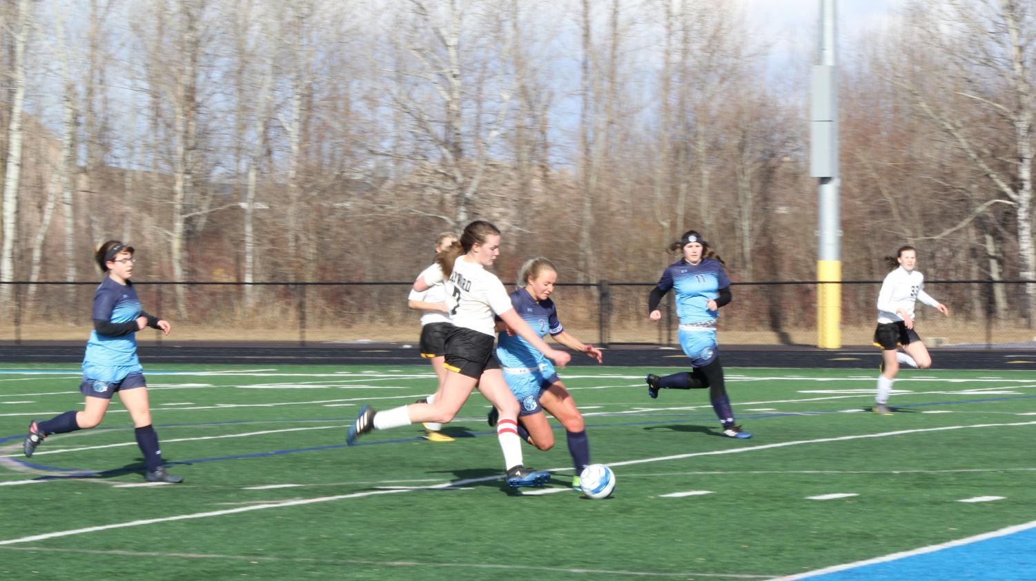 Senior Chloe Kintop (2) fights for the ball against Hayward at the NBC Spartan Sports Complex April 2, as sophomore Hannah Drake (left) and senior Megan Jaszczak (11) run beside her. The game ended in a 2-2 draw.