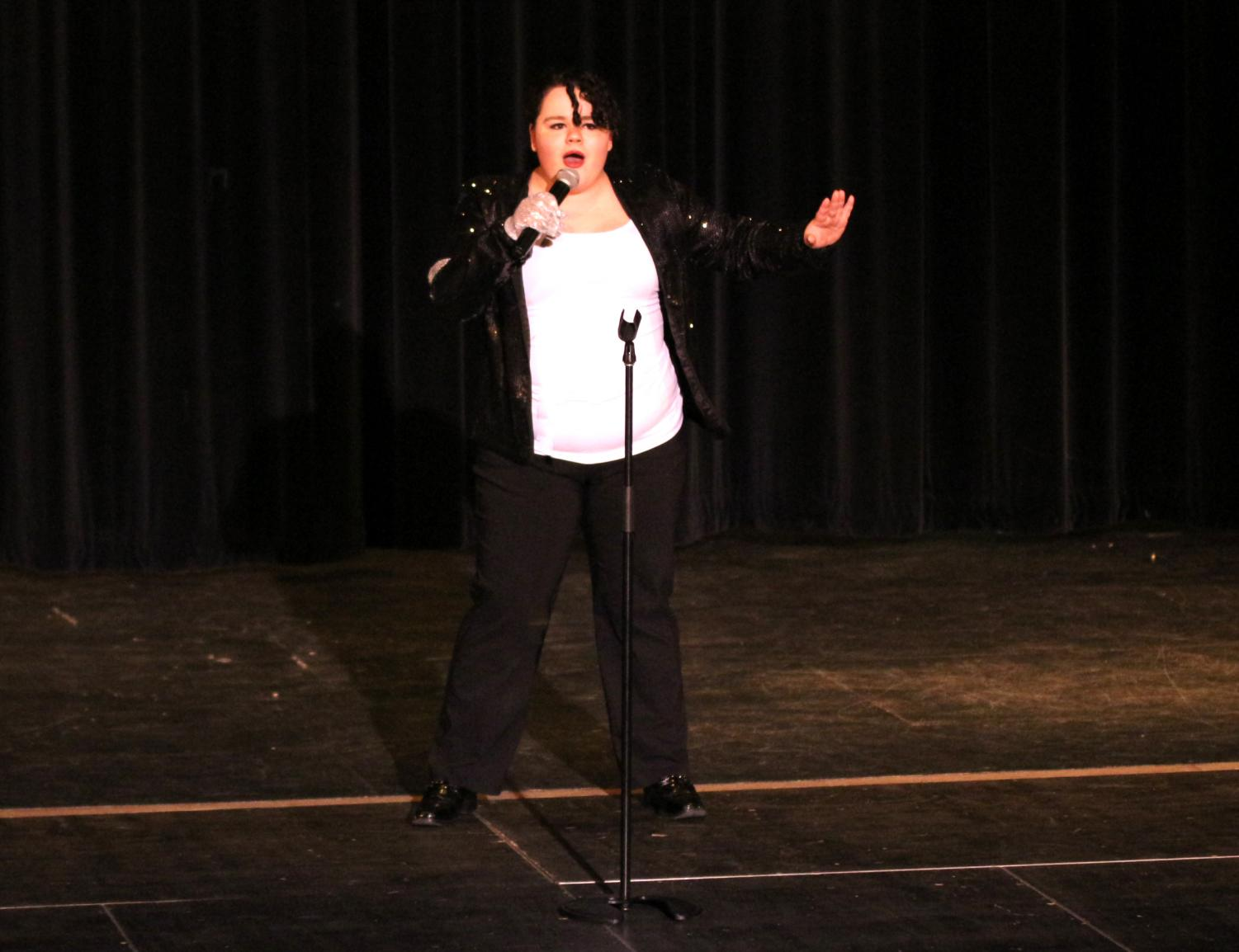 Sophomore Sydney Wanek performs a medley of Michael Jackson at the Pledgemaker's talent show in the PAC on April 24.