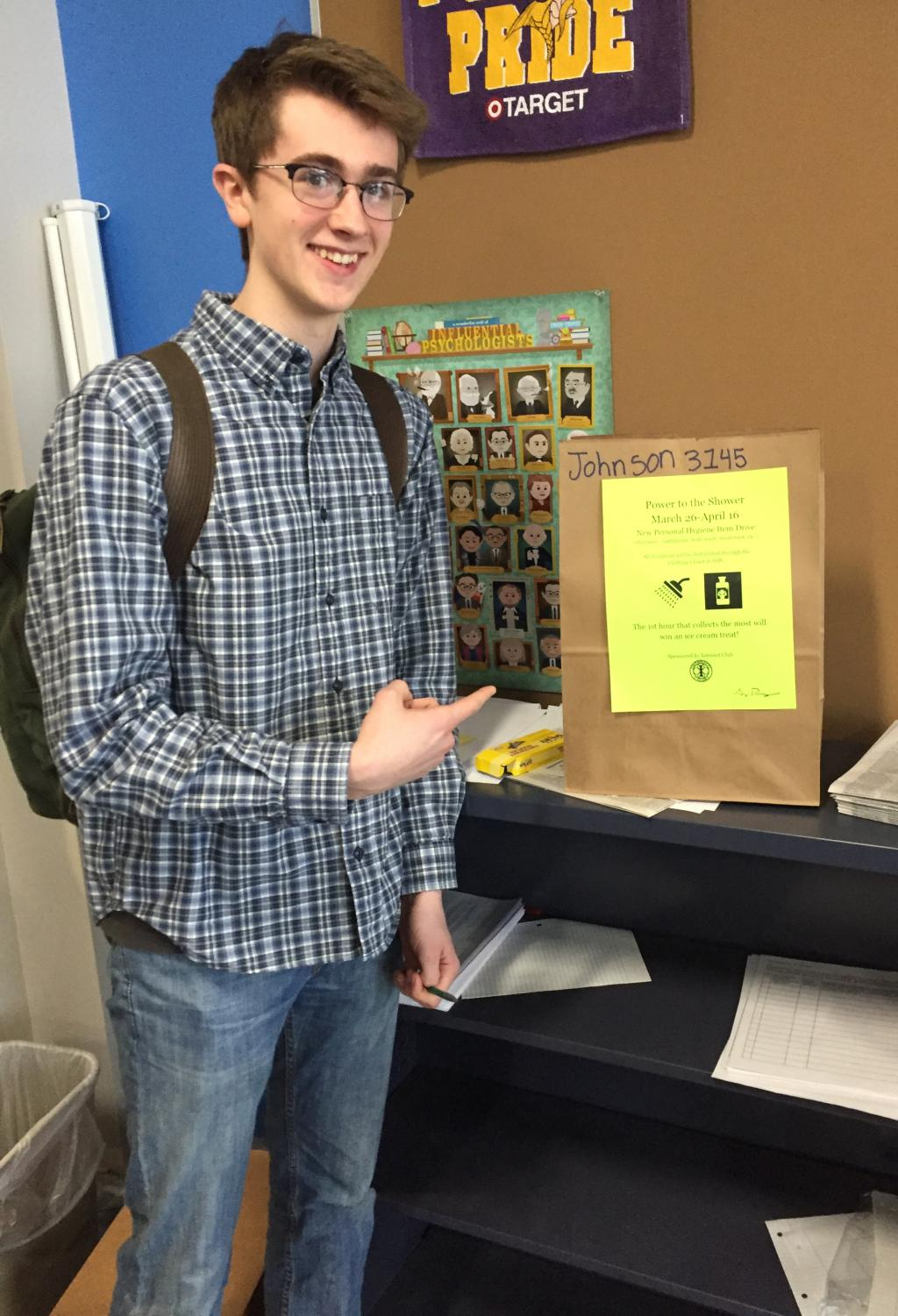 Interact club president senior Willem McClellan looks for donations in Keith Johnson's class' donation bag on April 8.