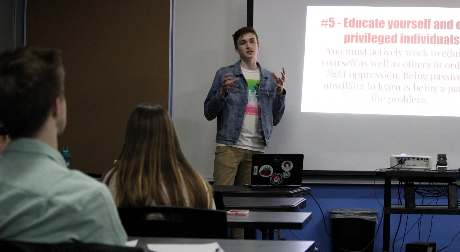 Thomas Chicka presents to a group of students and teachers on March 6 in the library conference room, informing them about privilege and how to become a better ally to the GLBTQ community.
