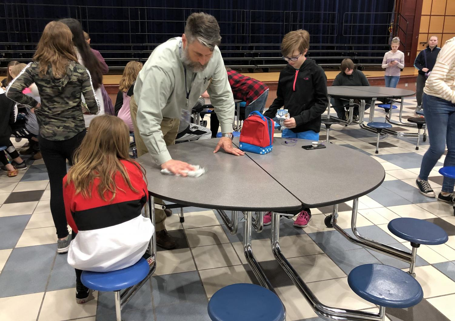 Rick Flaherty, current middle school principal, wipes down a lunch table in the middle school cafeteria on March 22. Flaherty will be moving up to SHS as its new principal for the 2019-2020 school year.