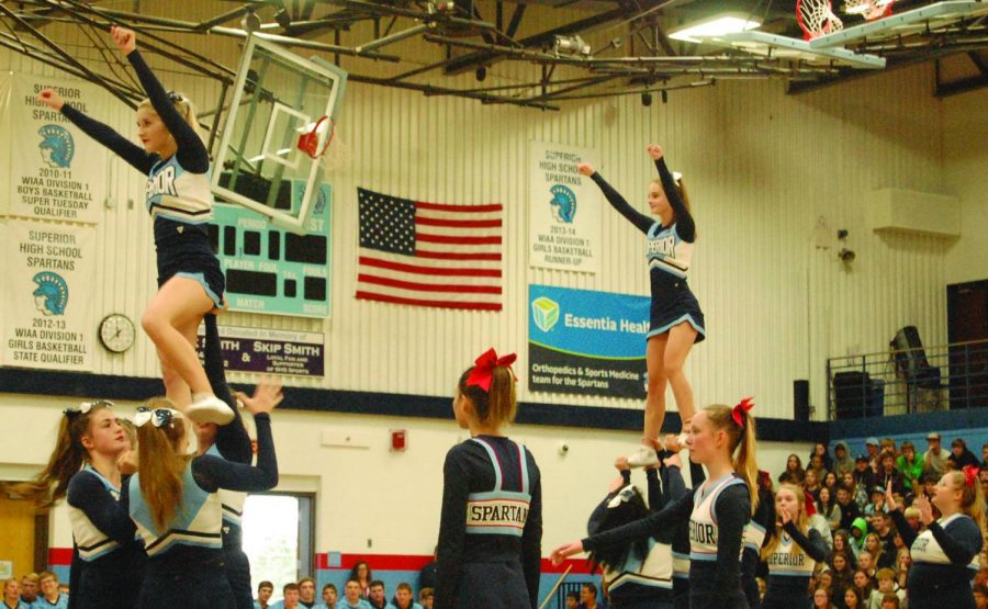 The Cheer team performs during the Homecoming assembly Sept. 27.