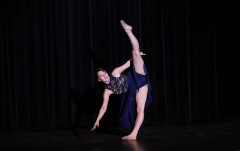 Junior Ivan Zambori does a leg extension during their dance at the Pledgemakers Got Talent show in the Performing Arts Center April 24. Zambori tied for third place with junior Ben Hintzman and freshman Natalie Sandor.