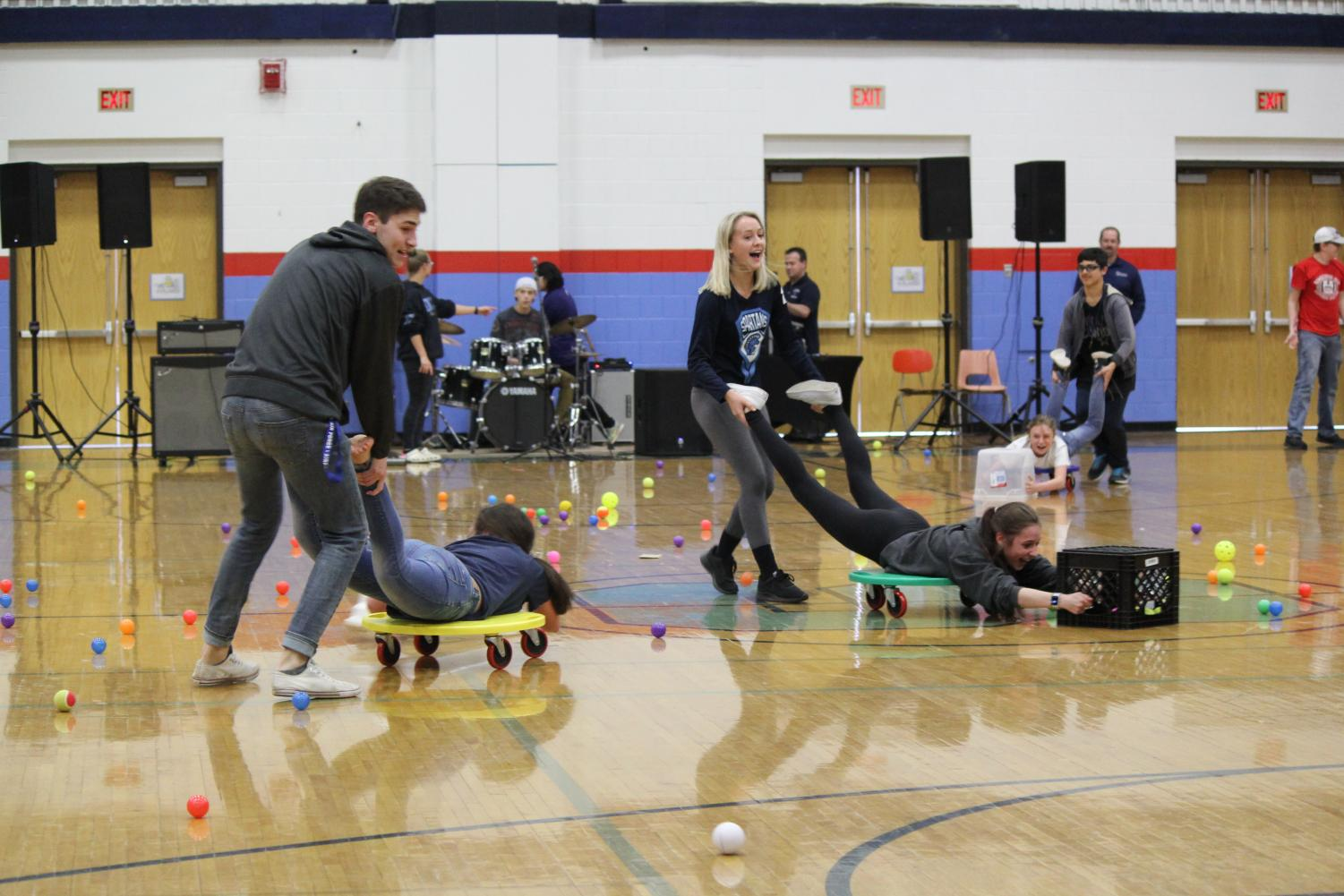 Seniors Maverick Peterson and Shannon McCoshen compete against Satori Rekstad and Katrina Jones in the SHS gym to gather balls during a game of Hungry Hungry Hippos on May 3.