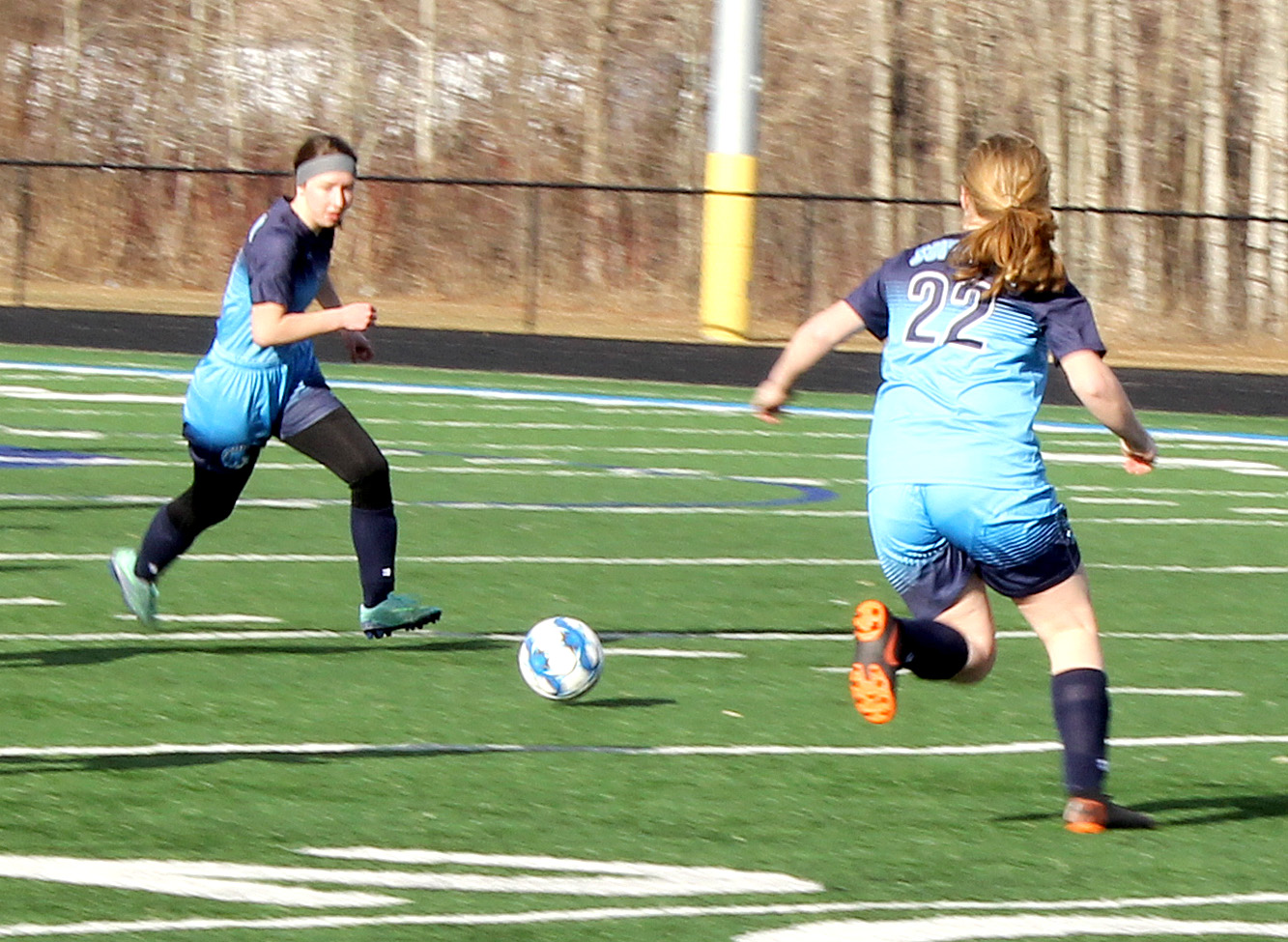 Senior Amelia Evavold (left) moves the ball up the field in a game earlier this season while freshman Lily Walrath (22) gets into position. Superior beat Chippewa Falls 4-1 at the NBC Spartan Sports Complex May 25 in the first round of the Wisconsin Interscholastic Athletic Association playoffs, and will play Kimberly tonight in Wausau at 5 p.m.